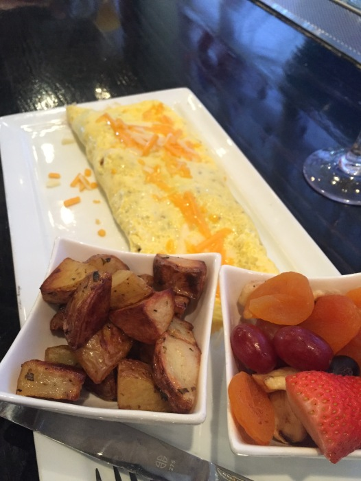 Three Egg Omelet w/ Poatoes & Assorted Fruit
